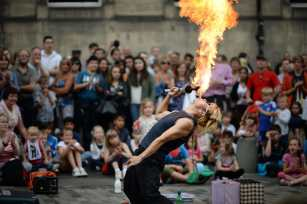 A street entertainer performs on Edinburgh's Royal Mile during the city's Festival Fringe. Scotland. (Jeff J Mitchell/Getty Images)