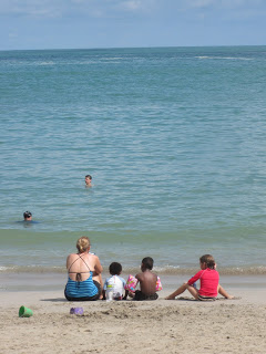 Joy, Oliver, Seth, and Annie at the beach