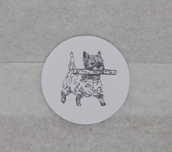 Cairn Terrier sticker closing the edge of a gift wrapped parcel