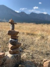 rocks stacked on top of each other on Open Space field