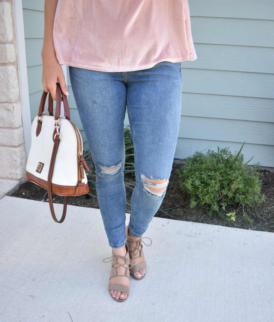 Velvet top with distressed jeans and Dooney and Bourke bag