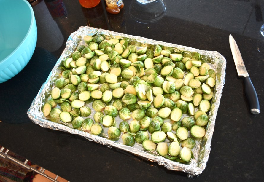 halved brussels sprouts on cookie sheet