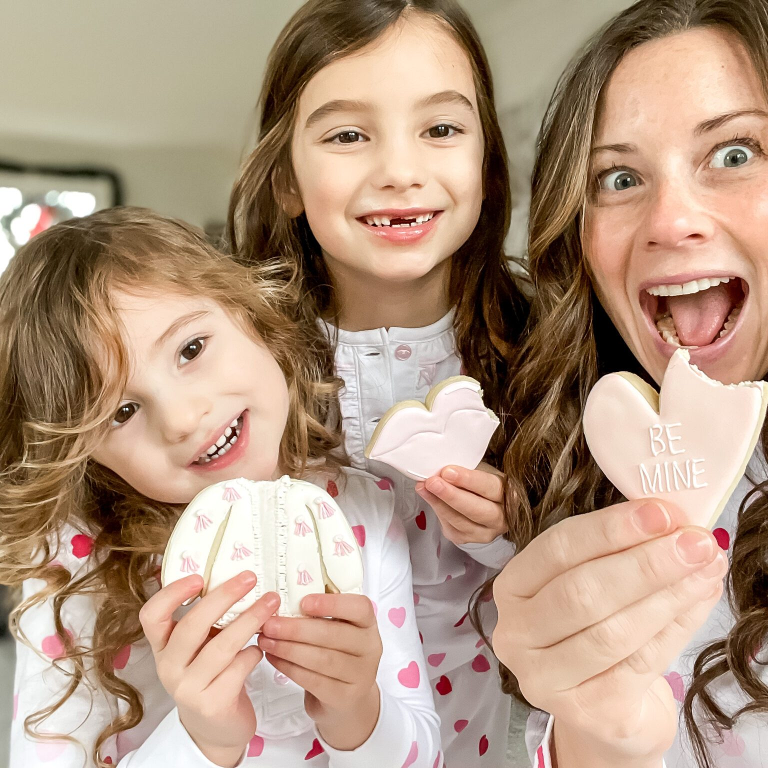 Mom and Daughters in heart pajamas with cookies