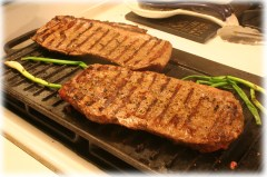 Grilling flat iron steak and green onions