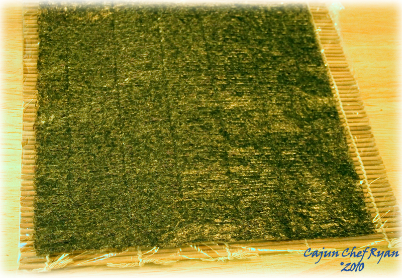 Nori sheet on plastic covered bamboo mat
