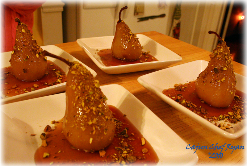 Four of the poached pears ready to serve