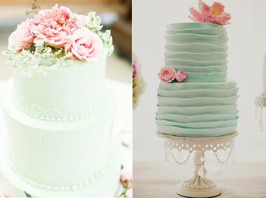 Round Shaped Four Tier Green Indian Wedding Cake Design Decorated With White Intricate Sari Embroidery Decorations And A Large Pink Lotus Flower
