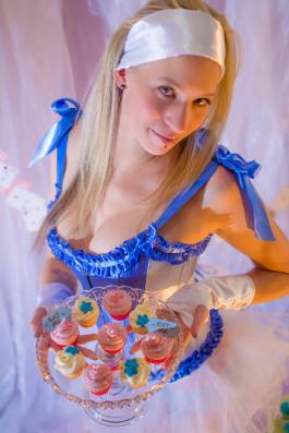 Here's Alice showing off her cupcakes (the ones from Cake Betty)... while I try to think of something to write up for Rapunzel. You'd think that a girl who likes to let her hair down would be easy to come up with a tagline for, right?