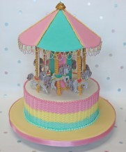 Image of a carousel cake in royal icing