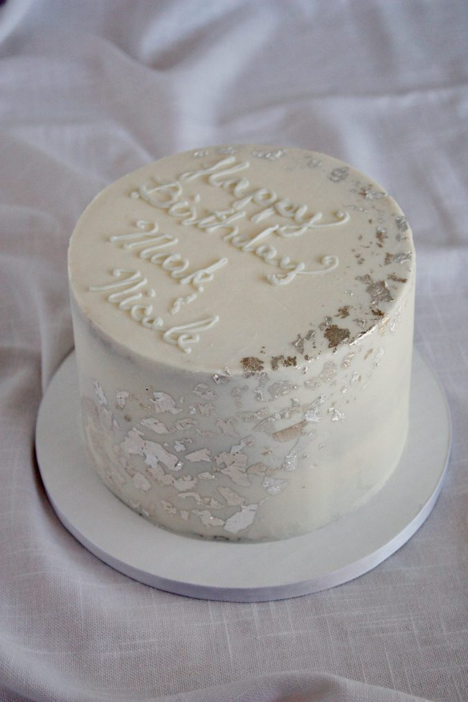 Monochrome birthday cake with silver leaf