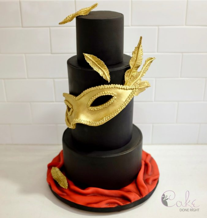 gold and black tiered masquerade cake