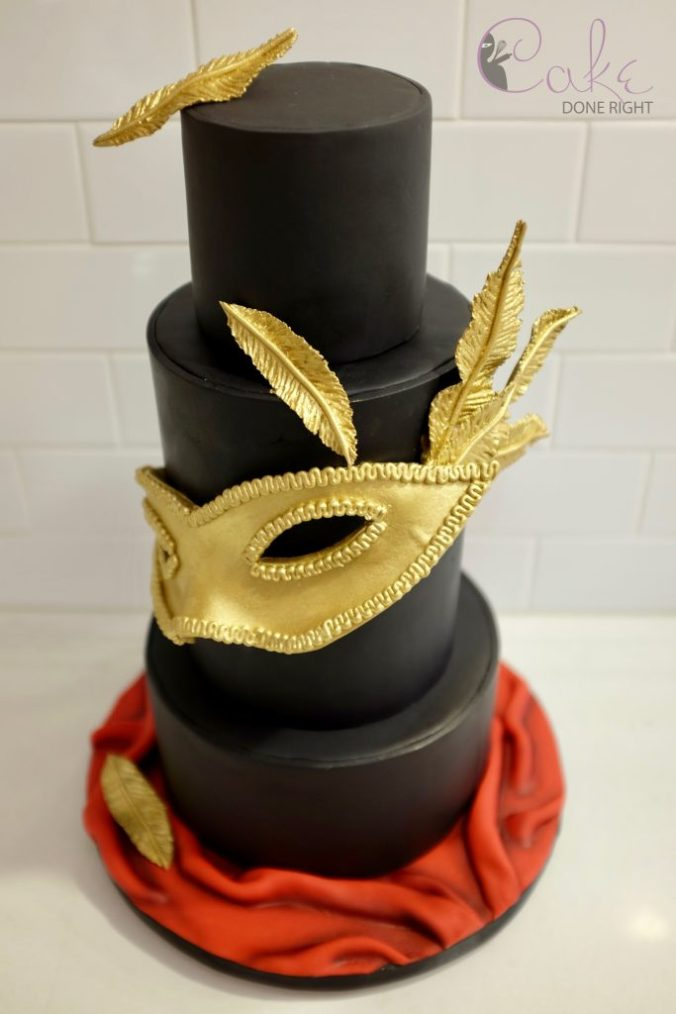 gold and black tiered masquerade cake soft arial