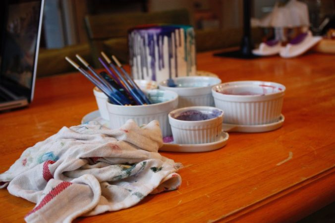 paint brushes, rag, color pots.