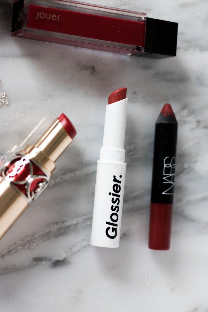 Red lipsticks for the holidays, NARS Cruella, Glossier Gen G Zip, Jouer Fraise Bonbon, YSL #4 Rouge in Danger, MAC Feels So Grand liquid lipstick