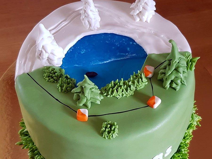 Slut-på-cancerbehandling-tårta med längdskidor och orientering