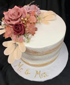 Round white wedding cake with sculpted flowers