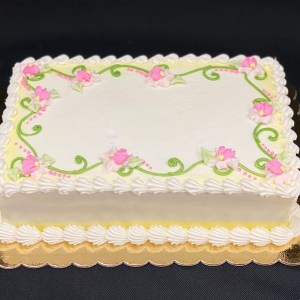 Rectangle frosted cake with flowers and vines