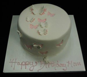 White cake with pink butterflies