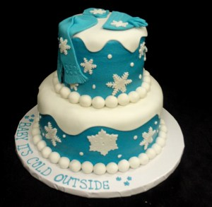 Two tiered blue and white winter themed cake