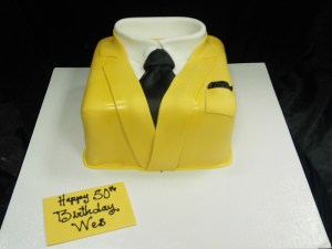 Sculpted cake yellow man's suit