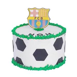 A soccer themed cake with FC Barcelona logo on top of the cake