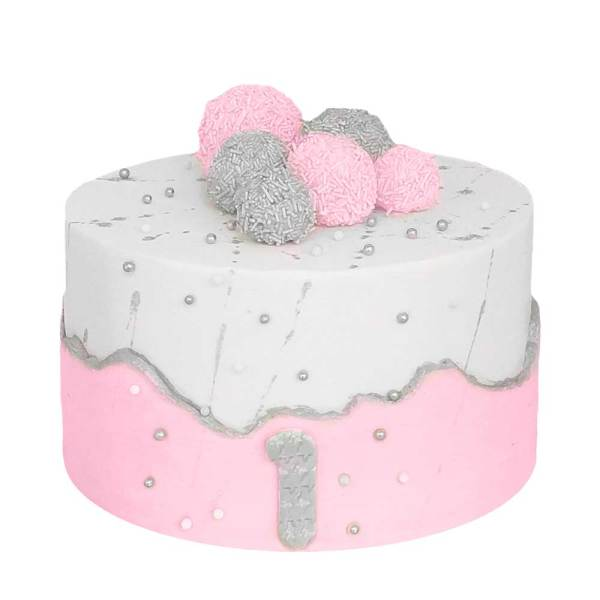 A cake with the top half white and the bottom half light pink with a couple of cake pops on top