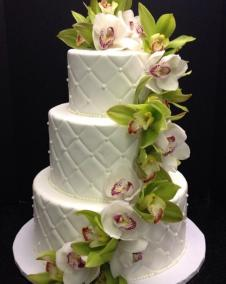 White quilt cascading orchids