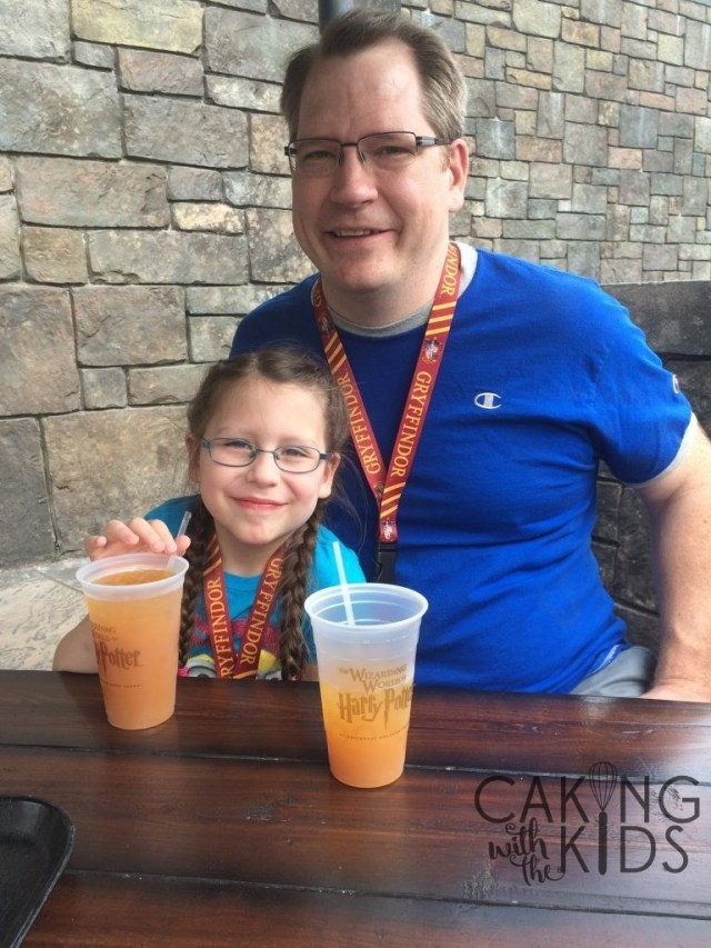 Caking Kid and Caking Dad with their Pumpkin Juice at Hogsmeade in Universal Studios Orlando.