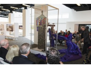 Father Christopher Smith, the rector and episcopal victor of Christ Cathedral, unveils the tabernacle by Egino Weinert at the 34-acre campus' Cultural Center on Tuesday afternoon. (photo courtesy of Event Image Services)