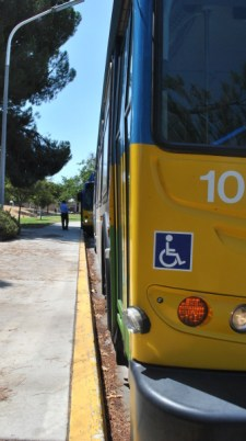 The buses wait as Vinson makes a phone call during a scheduled break at Cal State University Bakersfield. The CSUB and Bakersfield College lines were two of the routes overhauled in 2012 to accommodate a projected influx of riders as the city grows.