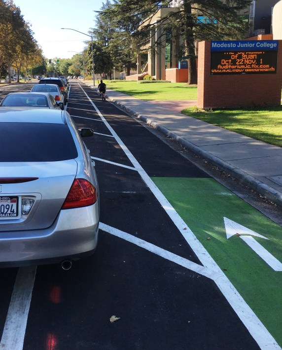 Car drivers are still figuring out how to park along the parking protected lanes.