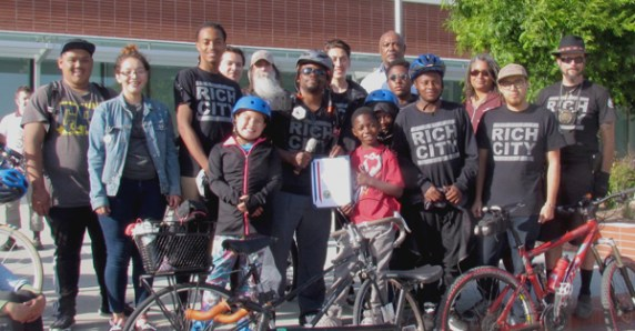 Najari Smith, center, and the Rich City RIDES crew pose with their Mayoral Certificate of Appreciation. Photo: Melanie Curry/Streetsblog