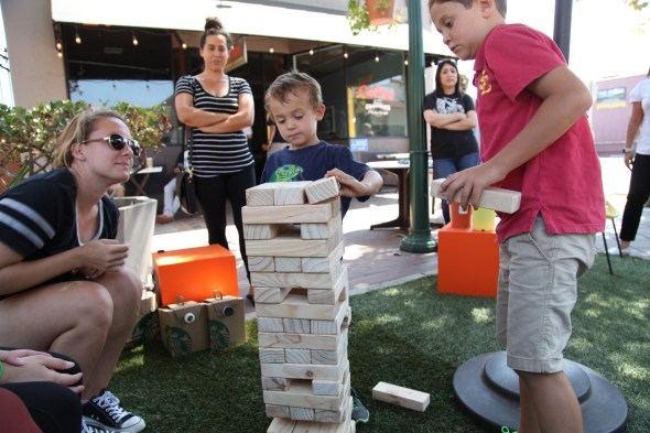 Lynk and Nolan play jenga at Garden Grove's parklet in Downtown Garden Grove. Photo by Kris Fortin