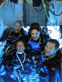 The crew of NEEMO 6 in the moonpool of underwater habitat Aquarius