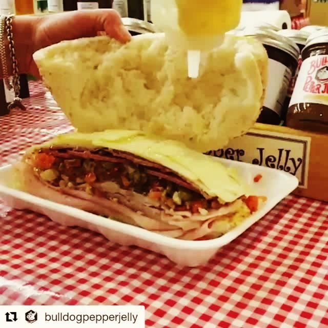 Muffaletta #slomo, courtesy of @bulldogpepperjelly…Thanks ladies! #Repost ・・・ @calandrosmkt muffaletta topped with Roasted Garlic Bulldog…
