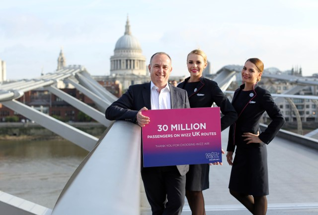 Owain Jones, Chief Corporate Officer of Wizz Air, celebrates 30m passengers flying with the airline from the UK.