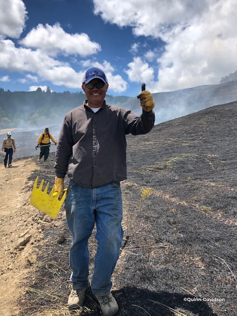 Man giving thumbs up during a prescribed burn