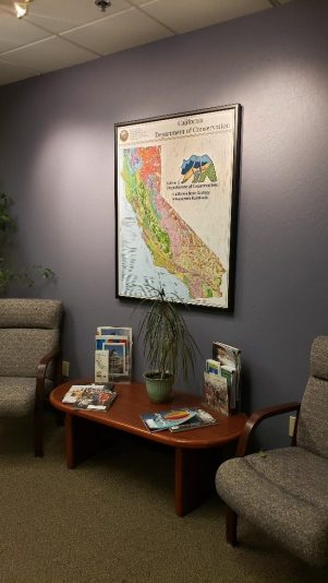 printed GIS map hanging on the wall in lobby.