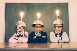 Three cute little kids with light bulbs over their heads