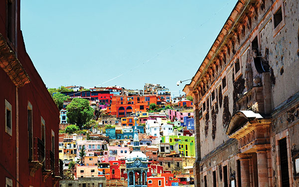 The romantic streets of Guanajuato are nestled amongst a valley of hills where architecture and colour collide into the most vibrant landscapes. Photo by Tatianna Ducklow.