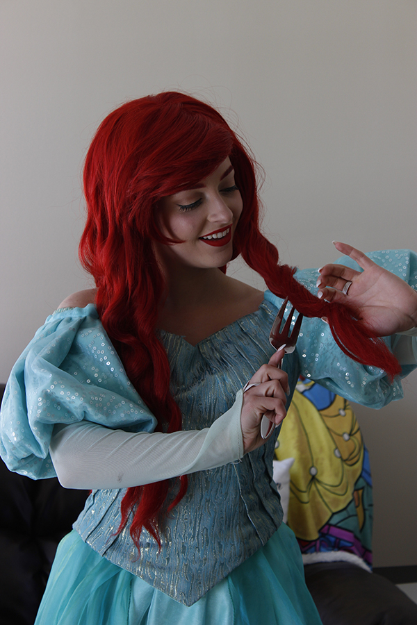 Makenna Llewellyn fully in character brushing her hair with a fork, just as the animated mermaid does in the film. Photo by Mackenzie Jaquish.