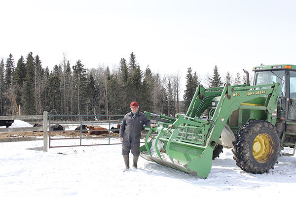 oy Sroka leans against his John Deere tractor after doing chores all morning on his ranch in Ponoka County, Alta. Despite it being April 1, there is still a foot of snow on the ground making everything more difficult. Photo by Stephanie Babych.