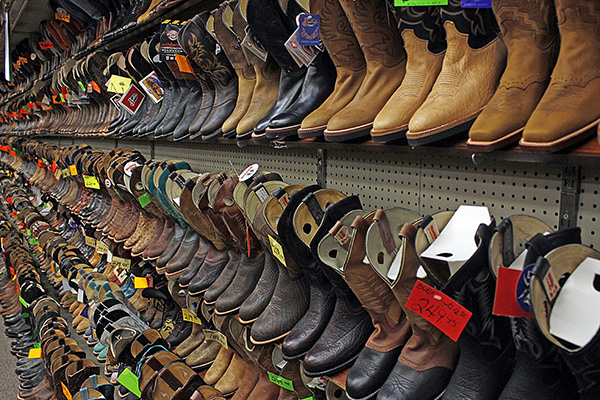 Long line of western boots at Wei's store. Photo by Casey Richardson.