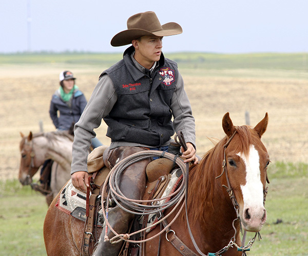 Riding on his family ranch near Big Valley on May 29, where the family gathered to brand cattle. Photo by Casey Richardson.