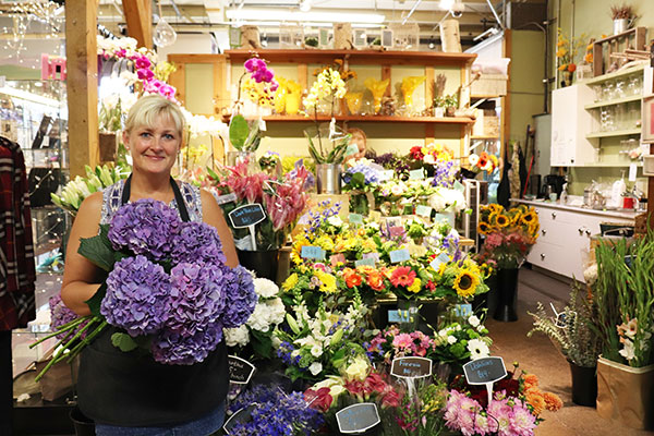 Kirsten Ottosen has always wanted to work with flowers, and loved moving to a shop in the market. Photo by Casey Richardson.