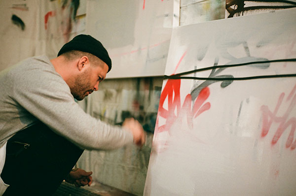 Graffiti artist David Bruning paints in his downtown studio. Photo Courtesy by Olivia Baychu.
