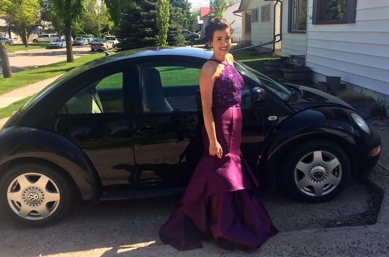 I posed with my 1999 New Beetle on my high school graduation day in 2017. Photo courtesy of Lauryn Heintz.