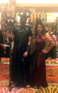 With his friends, Lord Hades and Lady Persephone