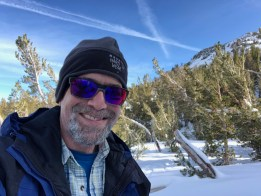 Mark taking a rest during a snowshoe excursion on Mt. Rose.