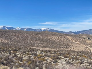 Houses and roads in the foreground with the northern part of the Carson Range in the background.